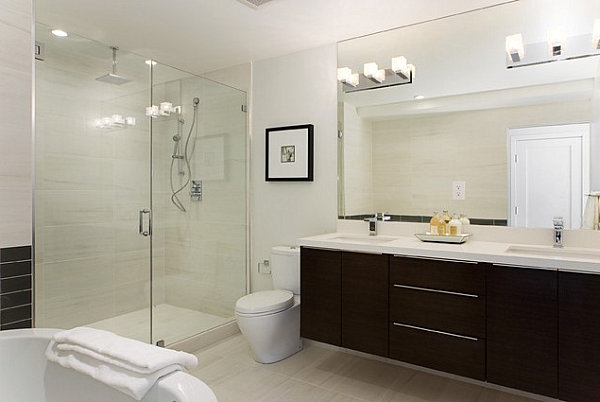 How to light a contemporary bathroom with wall sconces for Contemporary bathroom wall sconces